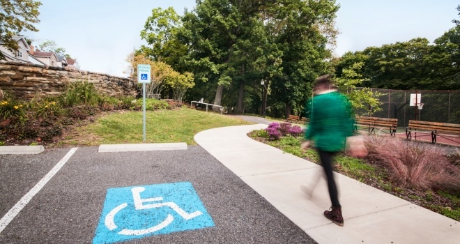 Image of someone walking near the rain garden and handicap accessible parking in McKinley Park