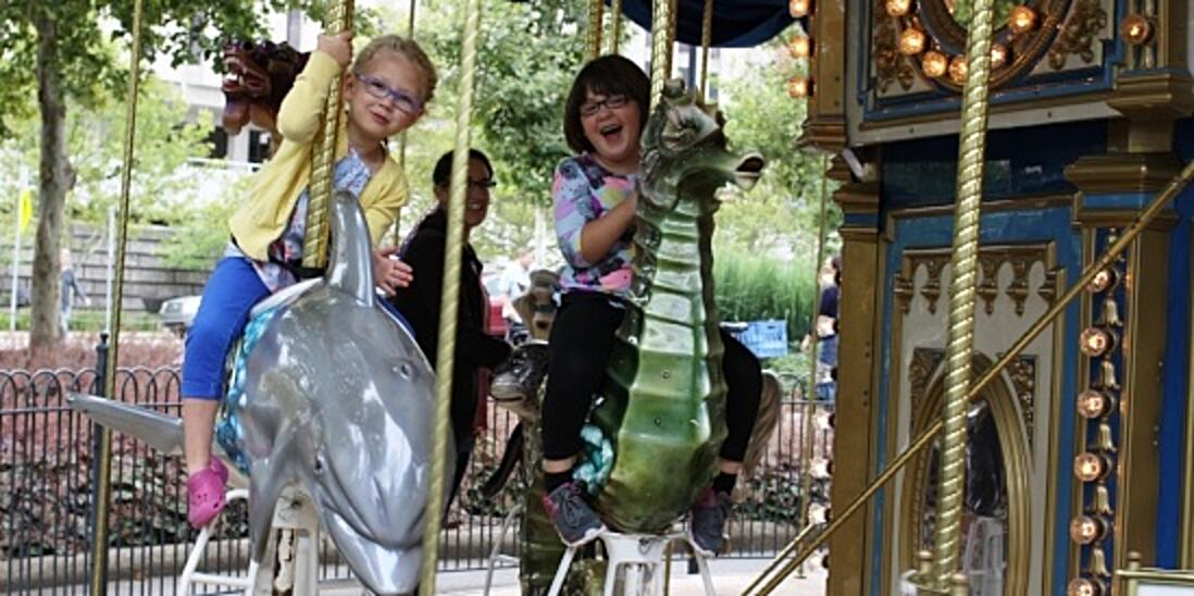 Image of two girls on the PNC Carousel