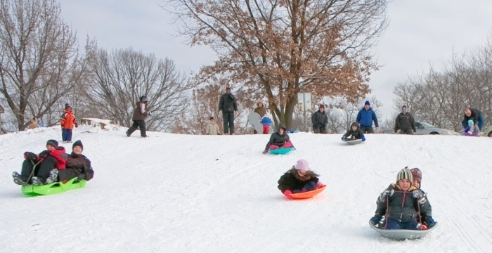 Image of kids sledding in Riverview Park