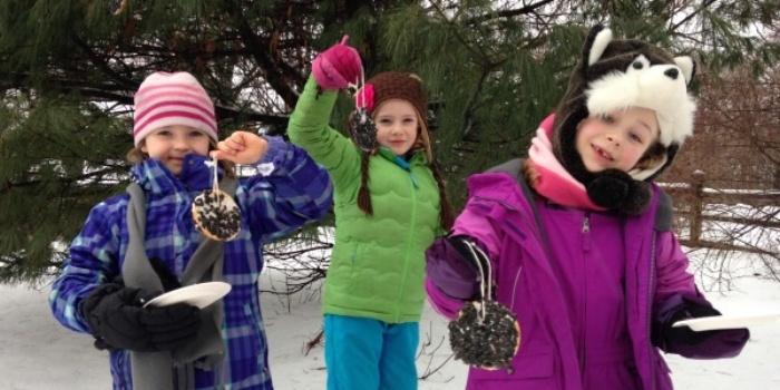 Image of three girls with bagel bird feeders
