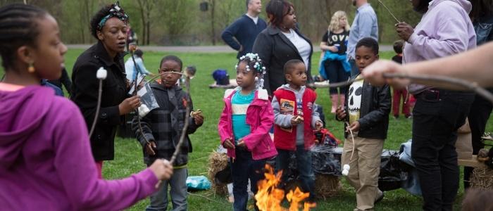 Image of families roasting marshmallows