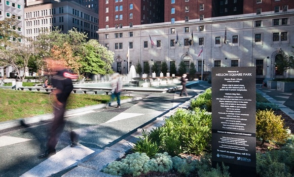 Image of people walking through Mellon Square