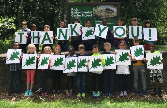 "Image of kids holding signs that spell out ""Thank You"""
