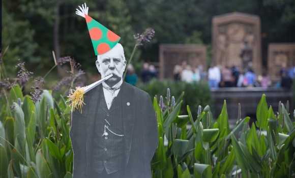 Image of a George Westinghouse cut-out with a birthday hat in front of his memorial