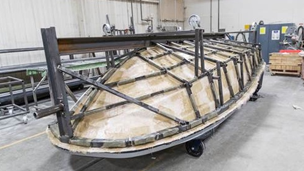 Finished frame on boat hull pattern after casting the fiberglass mold