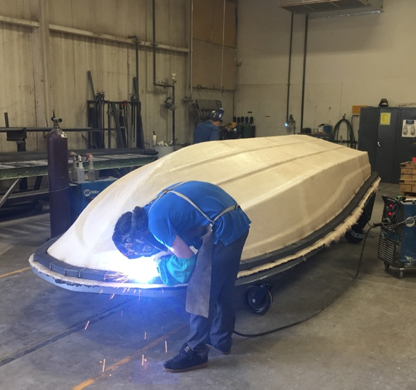 Building frame on boat hull pattern to pull mold