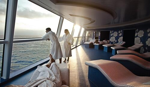 Canyon Ranch Celebrity Cruise spa couple in robes looking out window over ocean