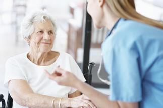 Elderly_Woman_with_Nurse.jpg