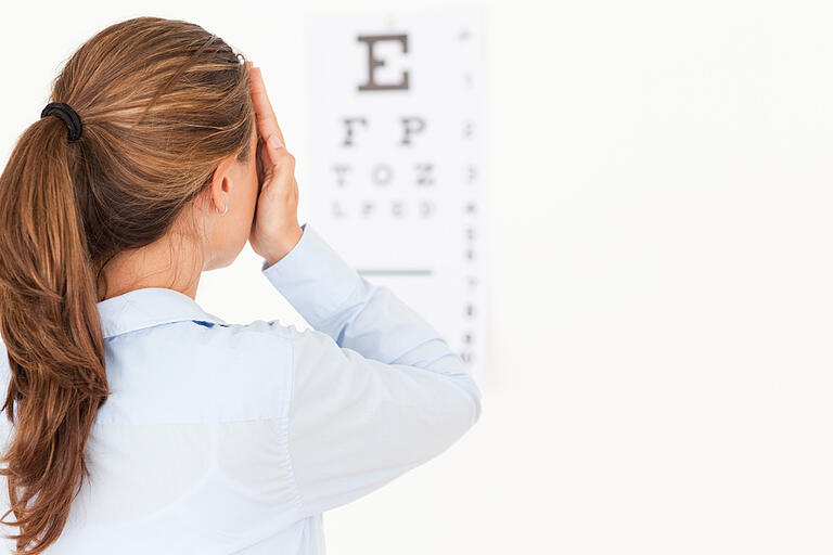 Brunette woman making an eye test in a surgery