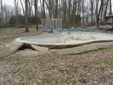 This concrete pool has floated (popped up from the ground).