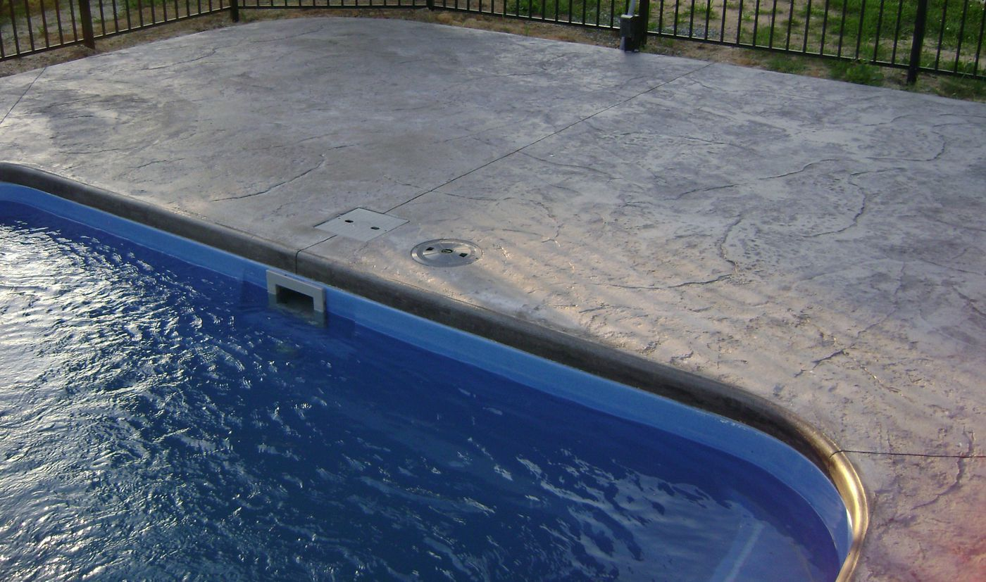 Stamped Concrete Around Pool Beauteous Patio Materials Stamped Concrete Vs Pavers