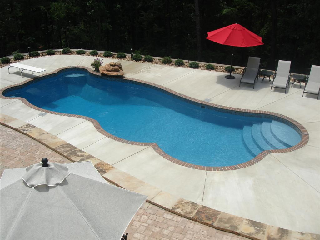 Fiberglass Pool Ideas planting of flowers or bushes in behind your retaining wall can really give your pool that wow factor The Best Inground Fiberglass Swimming Poolsdesigns Of 2013