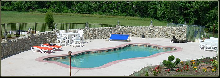 Fiberglass Pool with Stone Wall
