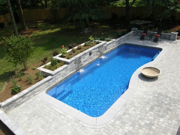 7 qualities of the best fiberglass pool builders in america for Top pool builders