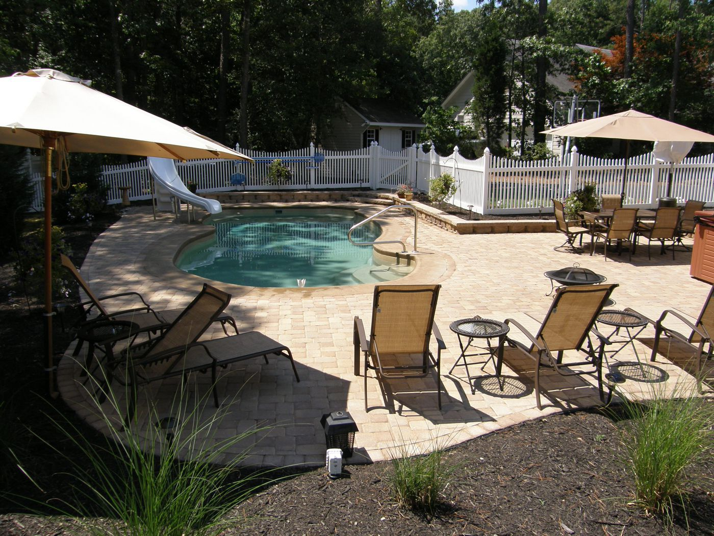 Pool patio materials stamped concrete vs pavers for Concrete pool designs