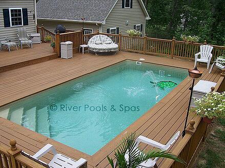 elevated fiberglass pool with wood decking