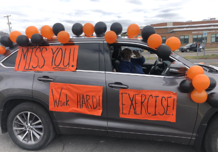 "New York Newsletter - A car with balloons and signs on it that say ""MIss You"""