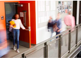 Fast paced school moving in hurried motion