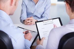 Two employers checking curriculum vitae of new candidate