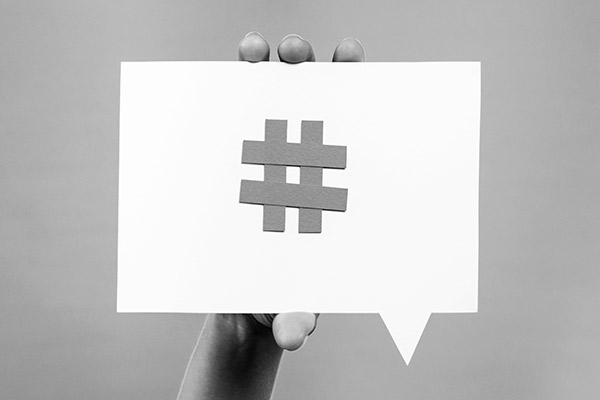 The hashtag sign on a white speech bubble, showing its importance for social media marketing strategy
