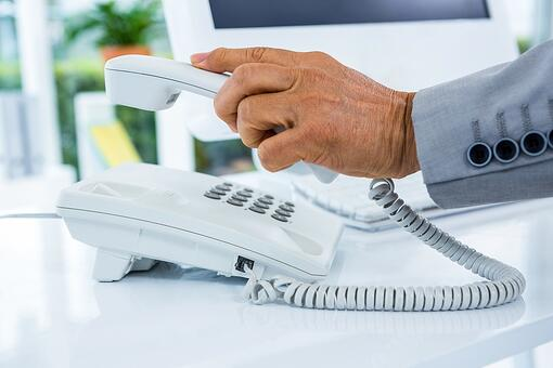 Businessman answering the phone in an office