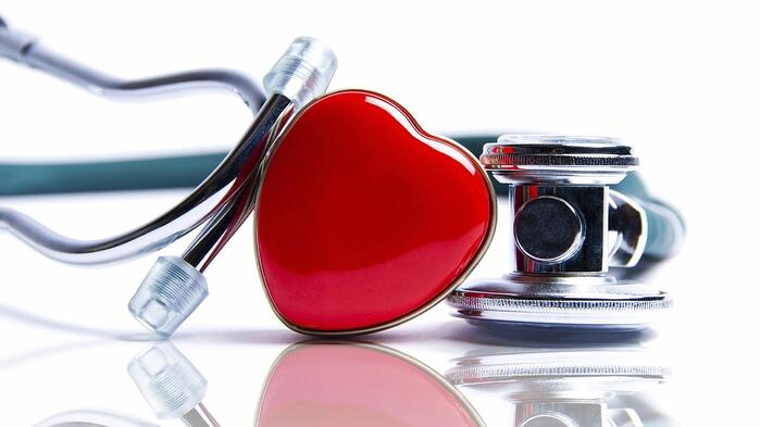 heart symbol next to a doctor's stethoscope