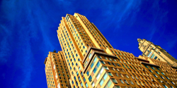 yellow skyscraper building and blue sky