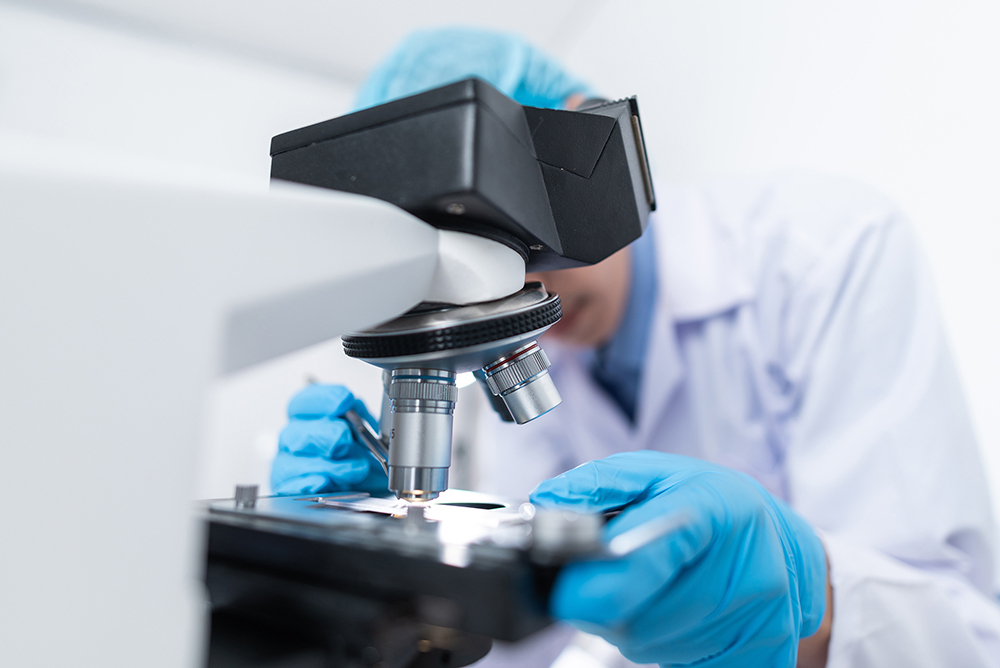 medical research examining in microscope