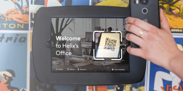 Proxyclick Touchless Check-In QR code scanning on front desk kiosk