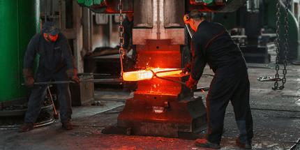 two men welding metal manufacturing