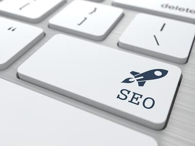 SEO. Button on Modern Computer Keyboard. Internet Concept. 3D Render.