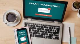 email marketing latop phone notepad desk