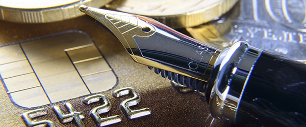 Close up shot of calligraphy pen and credit card