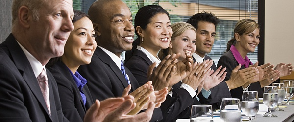 A row of businessmen and businesswomen clapping