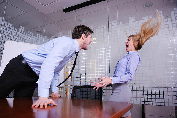 Angry business man screaming at employee in the office