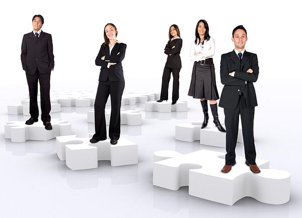 business teamwork on puzzle pieces over a white background