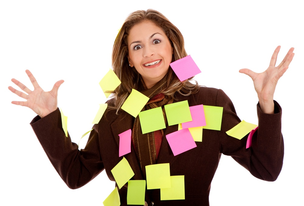 mulitasking business woman with post-its,  isolated over a white background