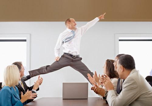 Man dancing in office