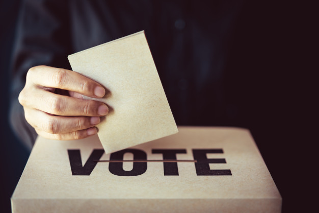 brown-paper-insert-vote-box-democracy-concept-retro-tone_34939-289