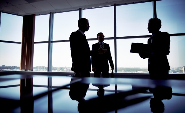 silhouette-of-an-executive-holding-a-clipboard_1098-2887