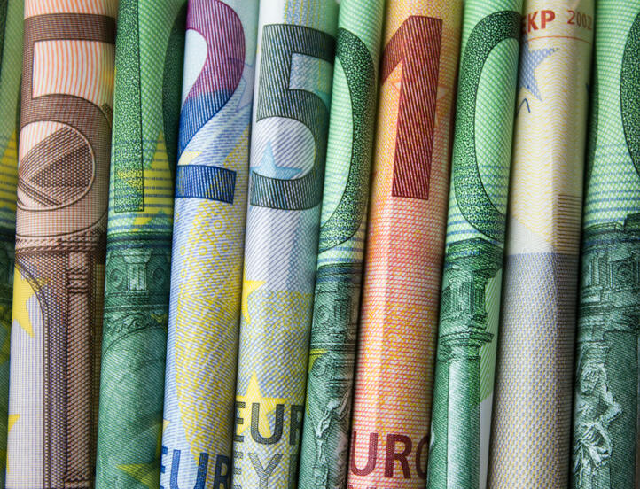 Shutterstock By hanohiki, euro bills rolled side by side, company's liquidity