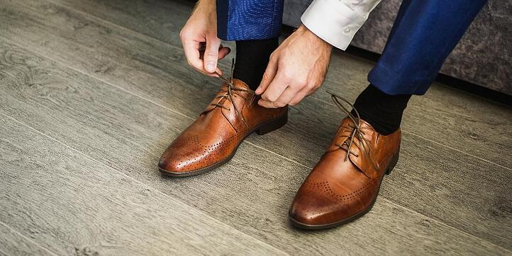 iiiphevgeniy by shutterstock, a man in a blue suit tie shis brown shoes