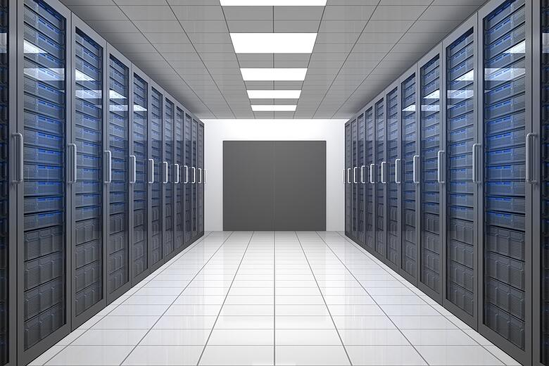 Empty hallway of tower servers in data centre