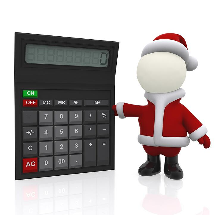 3D Santa with a calculator - isolated over a white background