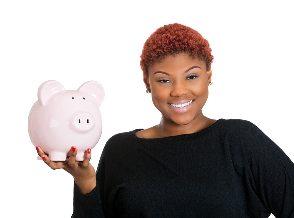 Closeup portrait of young woman holding her piggy bank friend in hand, isolate on white background. Positive emotion facial expression feelings. Smart wise saving paid financial decisions. Nest egg-1