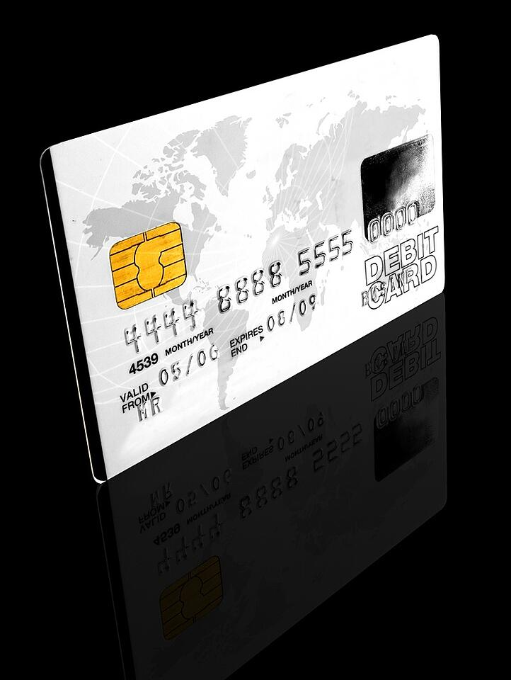 credit card over a black background - note the design of the card is my own and the numbers on the card are made up