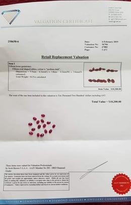 6a000287-037a-4ca0-bbd9-7f01da33f76e-relevant_material-15-oval-shaped-rubies-Certificate