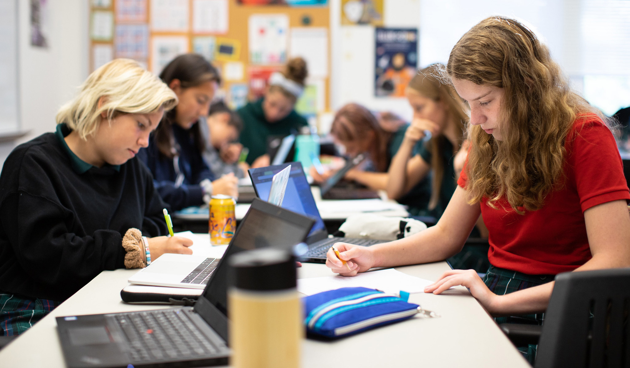 Computer science students at The Ellis School code together in class.