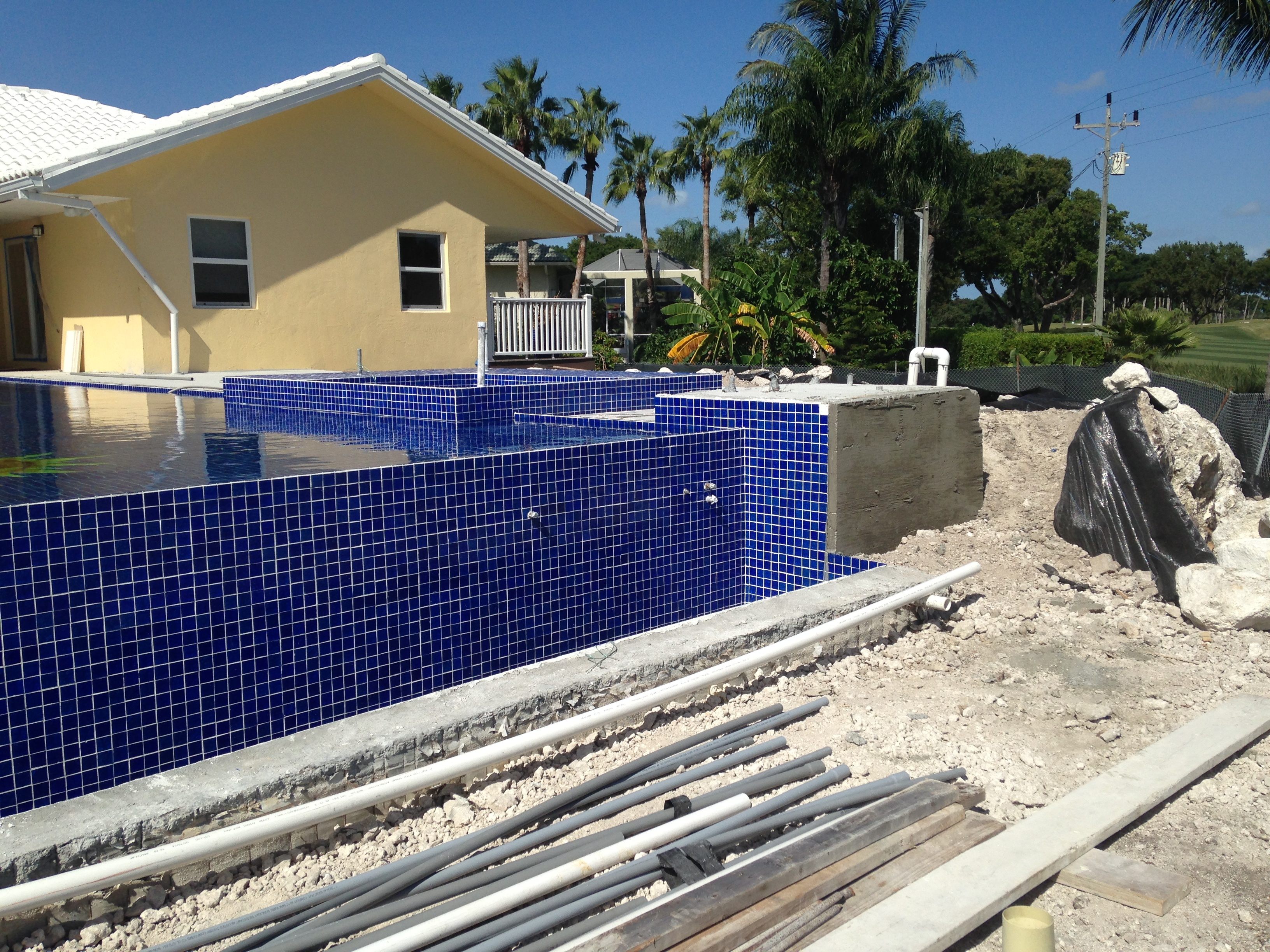 Pool spa services pool builders key largo miami for Spa construction