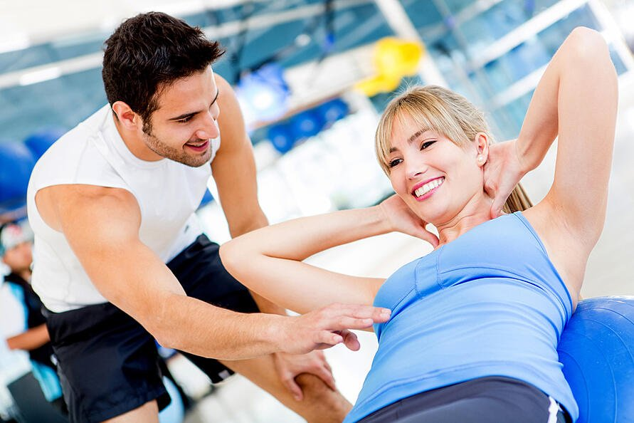 Gym woman exercising with her personal trainer-4